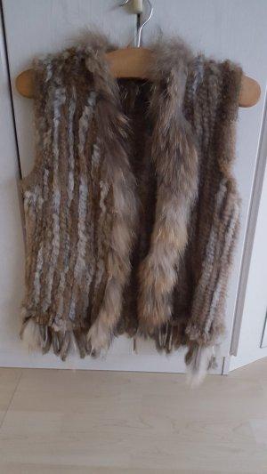 Smanicato di pelliccia marrone chiaro-marrone