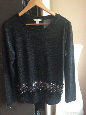 Schicker Pullover mit edlen Details