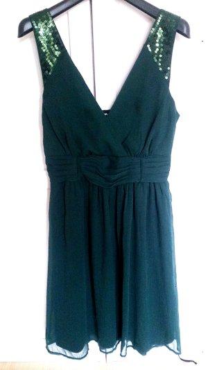 Schickes Kleid mit Pailettenbesatz an den Ärmeln