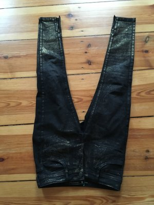 schlanke, schwarze Hose und Gold Französisch Marke Sinequanone s