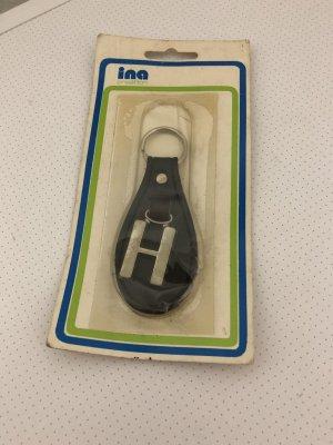 Porte-clés brun foncé