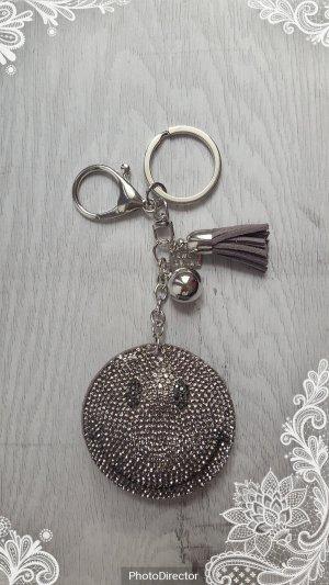 Schlüsselanhänger/ Taschenanhänger glitzer Smile grau/silber *NEU*