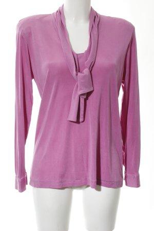 Blusa con lazo rosa estilo extravagante