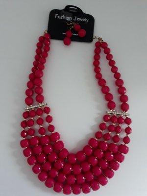 Collier incrusté de pierres rouge framboise-magenta