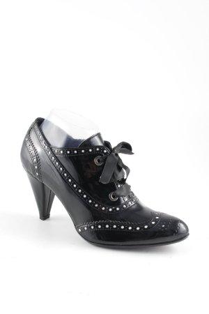 Patucos con cordones negro-blanco estilo extravagante