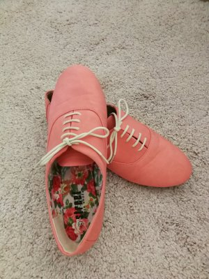 Zapatos brogue salmón