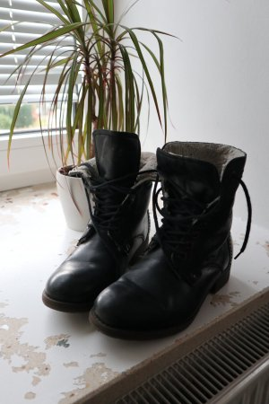 Botas con cordones negro Cuero