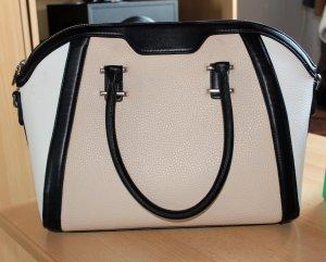 Schöne beige-schwarz-weiße Handtasche