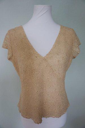 Schöne Bluse in goldener Farbe