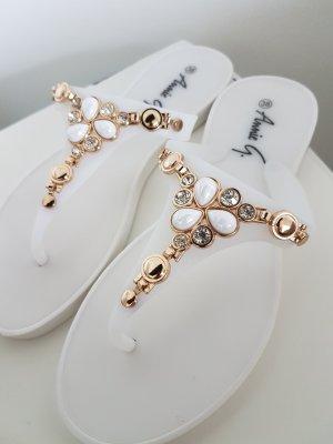 Sandalo infradito bianco-oro
