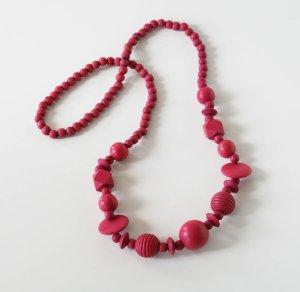 Collier de perles magenta bois