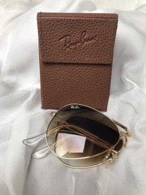 Schöne klappbare, goldene Sonnenbrille
