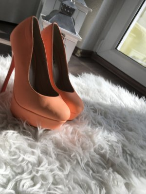 Schöne Pumps in neon orange