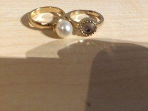 Schöne Ringe mit Perle und Stein