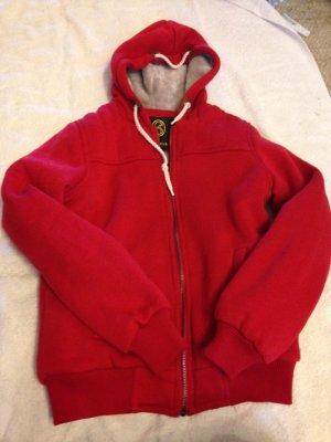 Chaleco con capucha rojo ladrillo