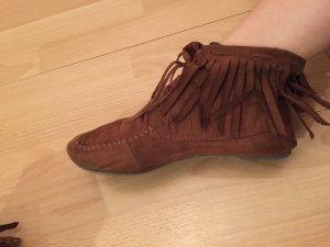 Schöne Schuhe mit Fransen wie minnektonka.