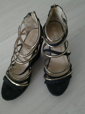 schöne schwarz / goldene sandalen