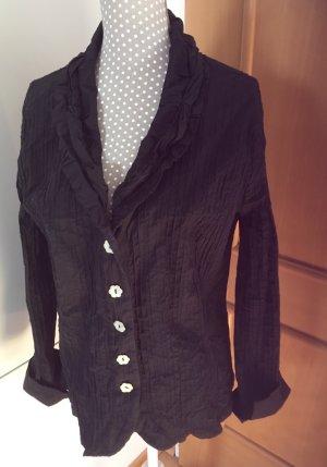 Schöne schwarze Blusenjacke