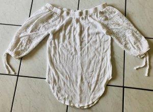 Schöne trägerlose Bluse in weiß