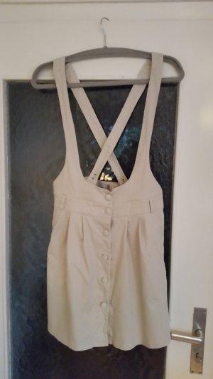 Schöner, cremefarbener Latzrock von Asos mit überkreuzten Trägern. 2 Taschen.