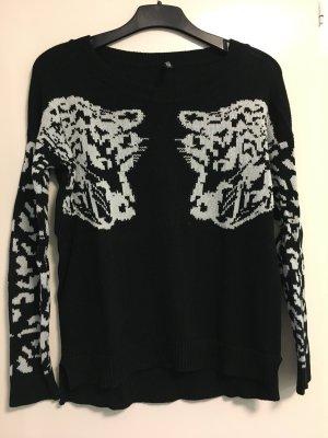Schöner Pullover mit Tigerköpfen