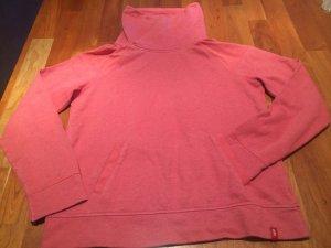 Schöner rosafarbener Pullover
