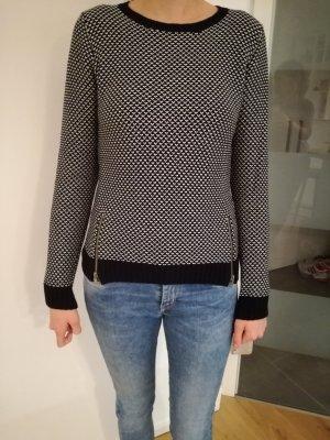 Schöner schwarz-weisser Pullover mit Reißverschlussapplikation