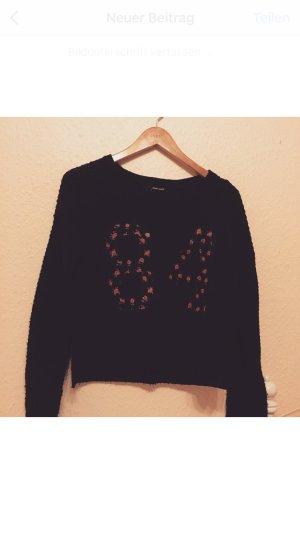 Schöner schwarzer Pullover