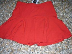 Falda con volantes rojo claro