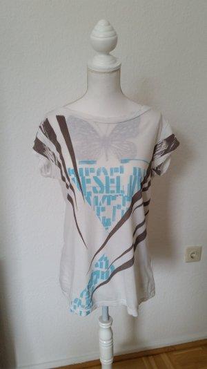 Schönes Diesel T-shirt in creme mit blau und braunem Print. Breiter Ausschnitt.