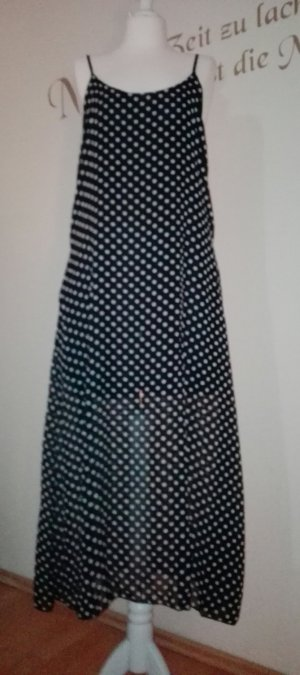 schönes, leichtes, schwarzes Sommerkleid mit weißen Punkten