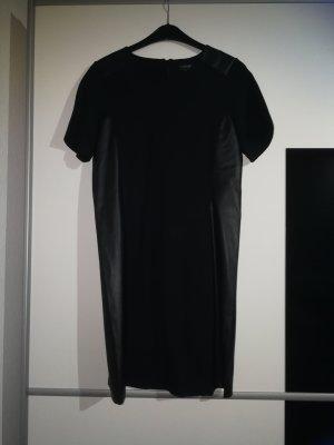 Schönes schwarzes Kleid / Longshirt mit Lederapplikation