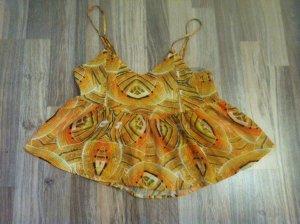 Schößchentop in orangenem Muster Pull&Bear