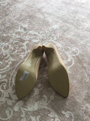 Zapatos formales sin cordones crema