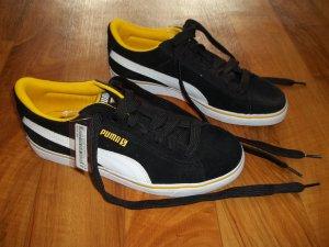 Schuhe von Puma in Gr. 38,5 schwarz gelb NEU