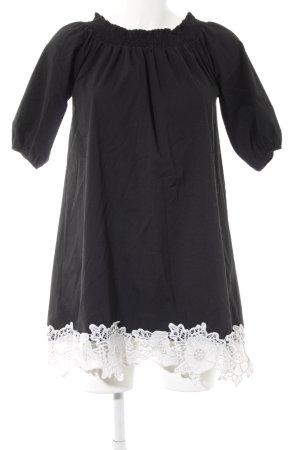 Off the shoulder jurk zwart-wit elegant