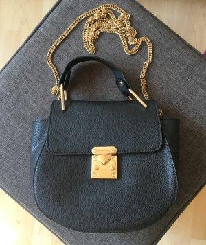 Schultertasche von COLLOSEUM im Cloé Style, schwarz/gold