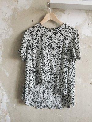 Schwarz gepunktete Crop-Bluse von Zara