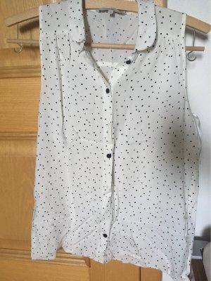 Schwarz gepunktete, elegante ärmellose Bluse