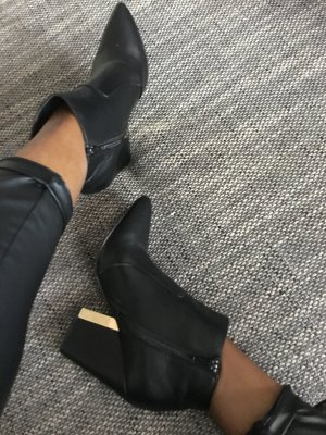 Schwarz / Gold ankle boots