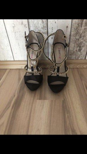Schwarz/goldene high heels