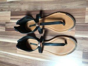Schwarz goldene Sandalen