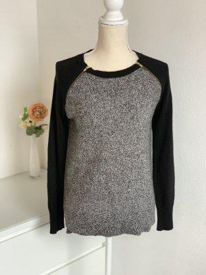 Schwarz-Grauer Pullover