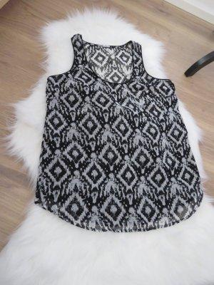 schwarz-weiß gemusterte ärmellose Bluse