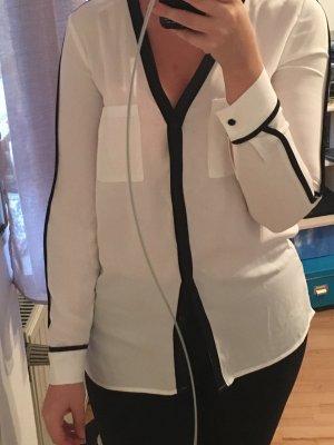 Schwarz / weiße Bluse
