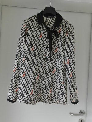 Schwarz-weiße Bluse mit Schluppe