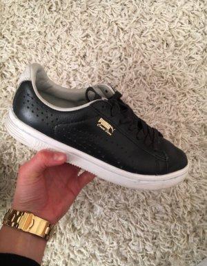 Schwarz-weiße Puma Schuhe