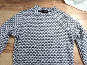 schwarz weißer pullover lang