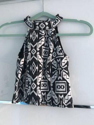 schwarz-weißes bauchfreies Top mit Azteken-Muster