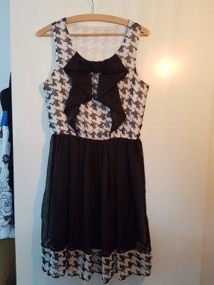 Schwarz/weißes Kleid mit Schleife